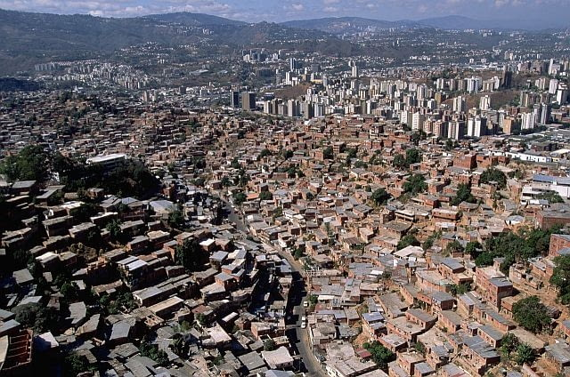 ca. 1970-1997, Federal District, Caracas, Venezuela --- Aerial View of Caracas Slums --- Image by Yann Arthus-Bertrand/CORBIS