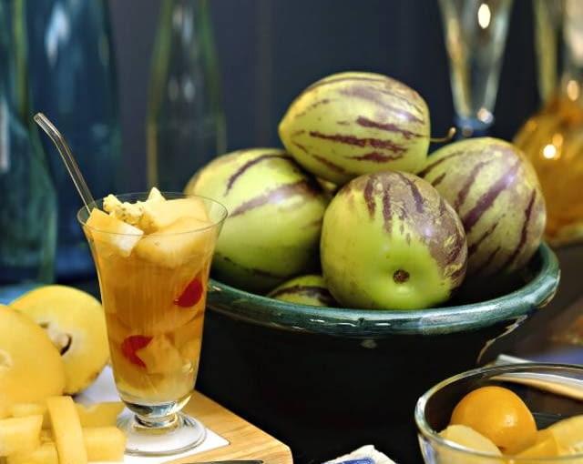 Pepinos in bowl and pepino cocktail (Solanum muricatum)