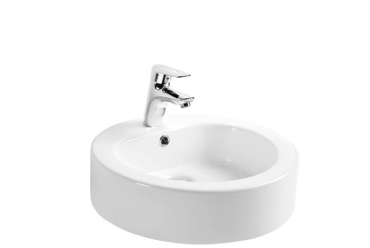 Soana/ARMATURA KRAKÓW. Umywalka nablatowa o średnicy 47 cm, wykonana z odpornej na zarysowania i substancje chemiczne ceramiki sanitarnej. Cena: 355 zł, www.grupa-armatura.com
