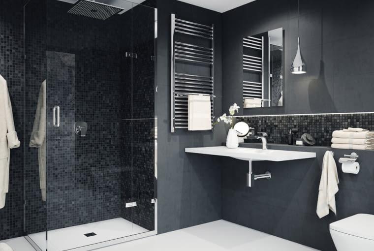 Czarny kolor do łazienki wprowadza elegancje i szyk. Nie sprawdzi się jednak w małych łazienkach bez okien. Tutaj do czarnych ścina dobrano białe sprzęty i podłogę. Wprowadzono tez modny prysznic bez brodzika.