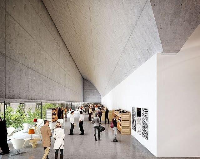 Kondygnacja na granicy betonu i szkła: wstęga okien u dołu pomieszczenia nadaje wnętrzom wyjątkowego wymiaru.