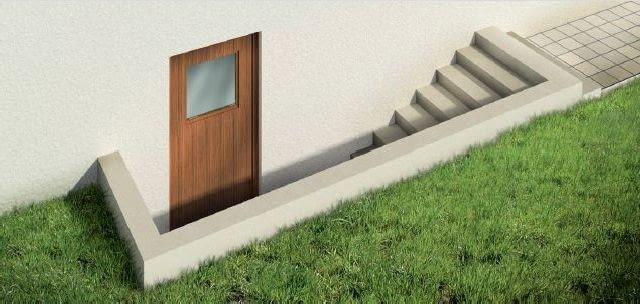 Sposoby zabezpieczenia domu przed zalaniem - podwyższona ścianka przy zewnętrznych drzwiach do piwnicy