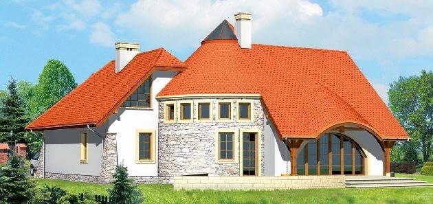 Rozbudowana bryła domu, ze skomplikowanym dachem i nietypowymi oknami
