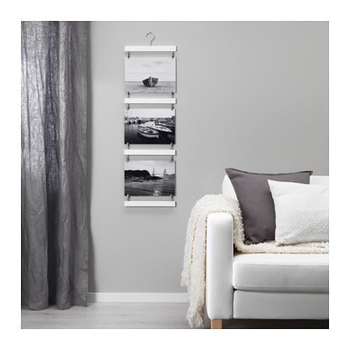 Zdjęcia na ścianie: jak powiesić i w co oprawić zdjęcia?