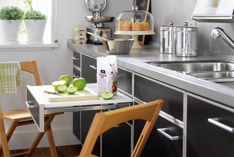 Space saving kitchen with drawer pull out table and wooden folding chairs SLOWA KLUCZOWE: InsideIndoorsinsideEquipmentFurnitureIndoorCollapsible ChairFolding ChairFolding CharKitchenKitchensKitchen FurnitureSpace-savingSpace savingChairChaiseChairsTableTablesLiveLiving