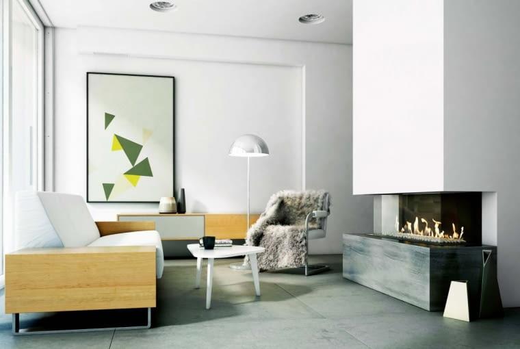 W minimalistycznych obudowach dekoracją jest sam ogień, dlatego otaczające go materiały są jedynie tłem. Często używa się więc neutralnej płyty gipsowo-kartonowe w połączeniu z kamieniem. Na zdjęciu: kamienny blat dolny, cena od 2000 zł, KRATKI.PL