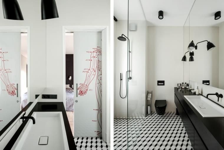 Z przestrzennym motywem tapety w sypialni korespondują czarno-białe płytki z kolekcji Barcelona zaprojektowanej przez Macieja Zienia. Na przesuwnych drzwiach zaskakuje grafika autorstwa Marii Widelak, przedstawiająca mapę energetyczną ludzkiego ciała.