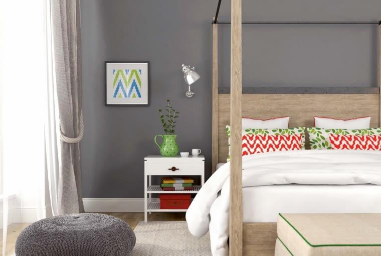 Szary kolor ścian jest neutralną bazą dla mebli i dekoracji. Barwa ta dobrze wygląda na ścianach sypialni.