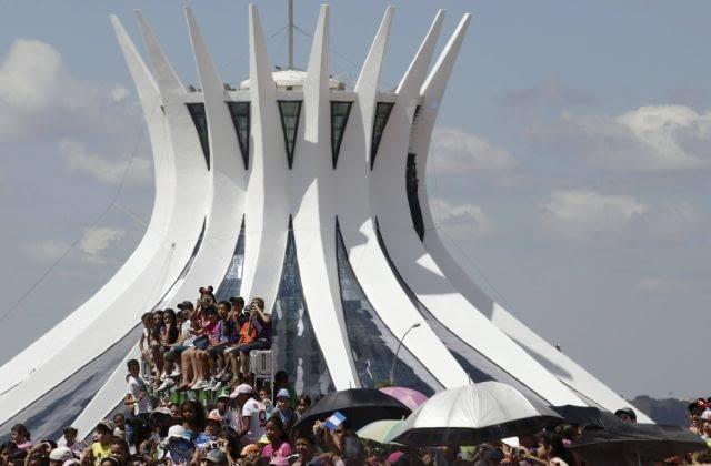 People attend celebrations marking the 50th anniversary of the founding of Brazil's capital Brasilia near Brasilia's Cathedral in Brasilia April 21, 2010. REUTERS/Ricardo Moraes (BRAZIL - Tags: ANNIVERSARY POLITICS RELIGION)