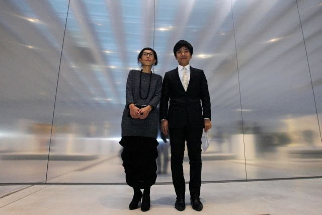 Japanese architects Ryue Nishizawa (R) and Kazuyo Sejima pose during the inauguration of Le Louvre-Lens Museum, in Lens, northern France, December 4, 2012. The Paris Louvre opens a regional offshoot this week in a former mining town in northern France, hoping to revitalise a region better known for football fans and takeaway chip stands than the noble pursuit of art. REUTERS/Michel Spingler/Pool (FRANCE - Tags: SOCIETY POLITICS)