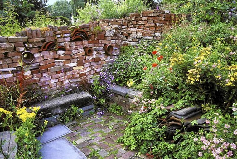 Drystone wall and colourful planting at Wildlife garden, 'Oase' in Netherlands