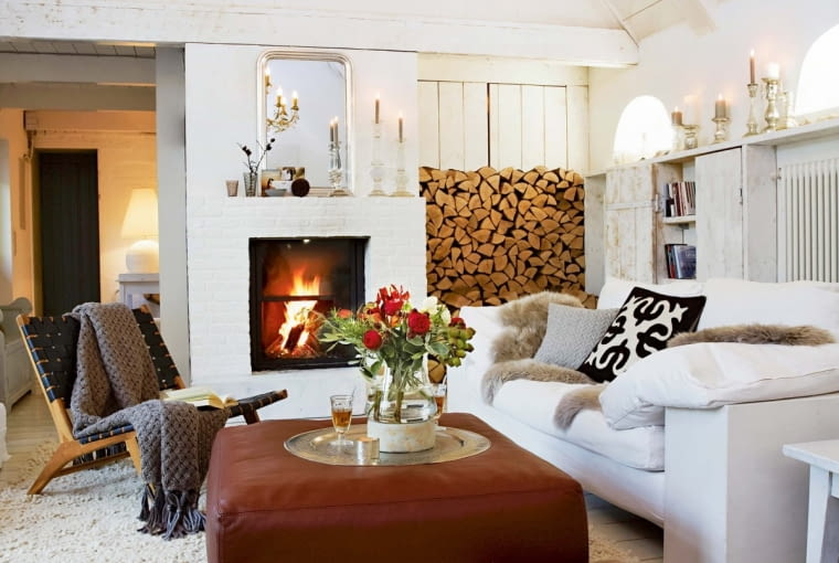 7Chair with blanket and white sofa in front of fireplace