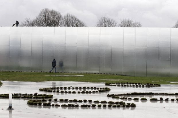 Workmen prepare the site of the Le Louvre Lens Museum, by Japanese architects Kazuyo Sejima and Ryue Nishizawa, on the eve of the inauguration of the museum in Lens, northern France, December 3, 2012. MANDATORY CREDIT Architects Kazuyo Sejima + Ryue Nishizawa SANAA REUTERS/Pascal Rossignol (FRANCE - Tags: SOCIETY)