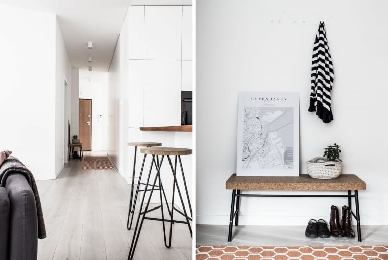 W korytarzu szafy porządkują przejście, dzięki czemu minimalistyczny efekt wow został zachowany. Mapa Kopenhagi na taborecie już od wejścia przypomina właścicielom o tamtym pamiętnym dniu. Przedpokój dzieli mieszkanie na część dzienną i nocną, prywatną - z sypialnią właścicieli, pokojem dziecka i łazienkami.