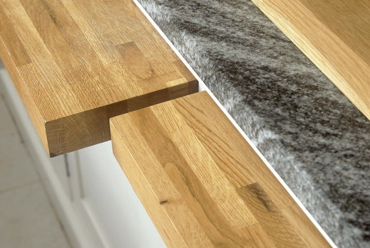 SA detail of a modern kitchen, a pull out kitchen chopping boards, with fresh limes.