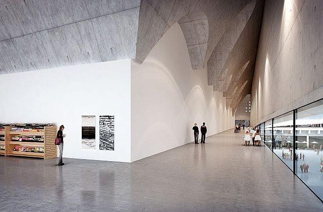 Wnętrza części ekspozycyjnej pod łukowym sklepieniem. Okrągłe świetliki nadają wręcz sakralnego wymiaru. Surowość, oszczędność wyrazu, przestronność będą sprzyjać podziwianiu ekspozycji.