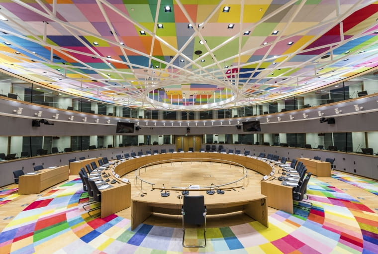 Colourful carpets decorate the main meeting room at the Europa building in Brussels on Friday, Dec. 9, 2016. From the beginning of 2017, the Europa building becomes the home of the two institutions representing the EU member states: the Council of the European Union and the European Council. (AP Photo/Geert Vanden Wijngaert)