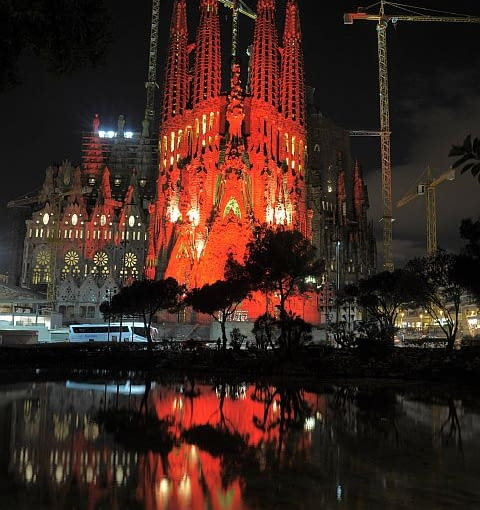 The Sagrada Familia church designed by architect Antoni Gaudi is seen covered with red lights to commemorate World Aids Day in Barcelona, Spain, Wednesday, Dec. 1, 2010. (AP Photo/Manu Fernandez)