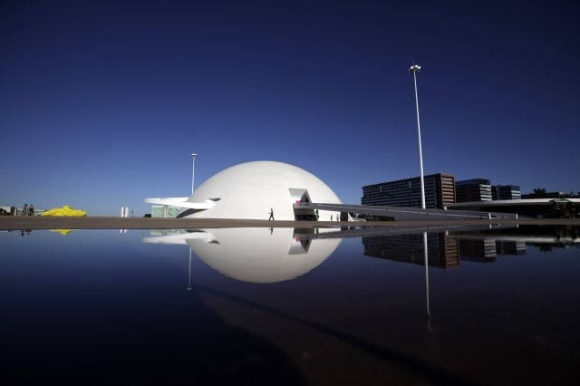 The Brazilian National Museum, designed by architect Oscar Niemeyer, is seen in Brasilia April 7, 2010. The dream was big. In just a few years, Brazil would build a modern capital in the middle of a savanna, an experiment in egalitarianism that would also shift power toward the center of the vast country. As Brasilia turned 50 years old on April 21, 2010, vestiges of that dream live on in Oscar Niemeyer's soaring architecture, the uniform residential apartment blocks, and the plane-like city shape that legend has it was meant to signal the Latin American giant's take-off. Picture taken April 7. To match Feature BRAZIL-BRASILIA/ REUTERS/Ricardo Moraes (BRAZIL - Tags: ANNIVERSARY)