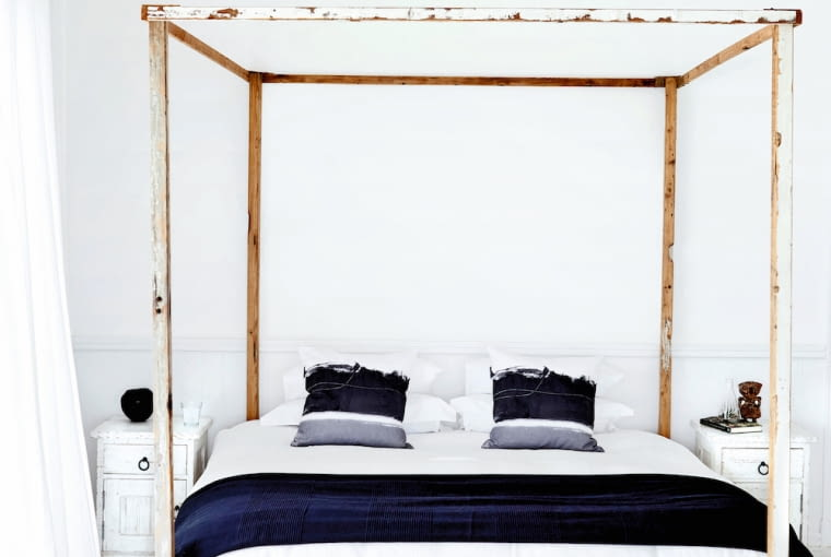Rustic four poster bed