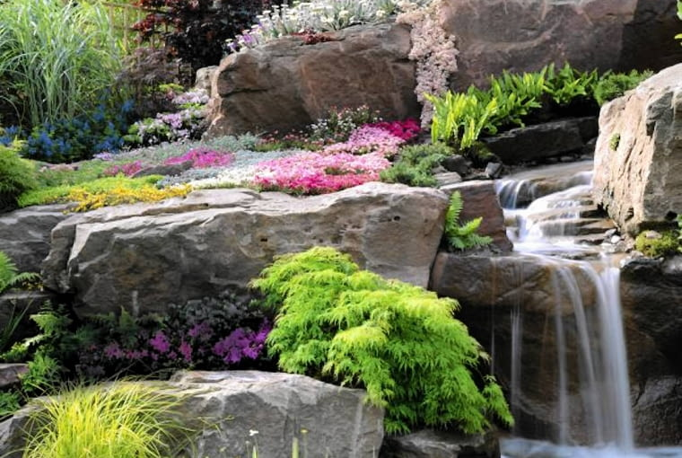 Waterfall through rocks with alpine plants, Asplenium and Aquilegia. The Alpine Garden Society's 'Magic of the mountains' - Chelsea 2000