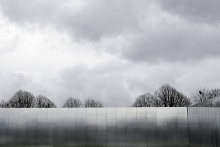 A workman walks on the the roof of the Le Louvre Lens Museum, by Japanese architects Kazuyo Sejima and Ryue Nishizawa, on the eve of the inauguration of the museum in Lens, northern France, December 3, 2012. MANDATORY CREDIT Architects Kazuyo Sejima + Ryue Nishizawa SANAA REUTERS/Pascal Rossignol (FRANCE - Tags: SOCIETY)