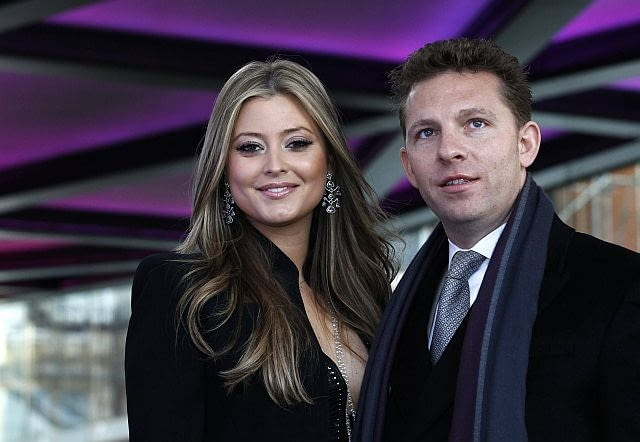Property developer Nick Candy and actress Holly Valence pose for photographers at the launch of One Hyde Park in London January 19, 2011. REUTERS/Luke MacGregor (BRITAIN - Tags: ENTERTAINMENT BUSINESS)