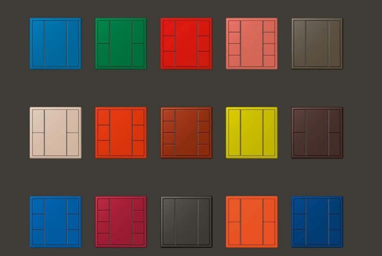 Le Corbusier, jeden z ojców współczesnej architektury opracował system 63 kolorów oparty na barwach natury. Możemy kupić włączniki w jednym z tych kolorów. W bardzo klasycznej linii LS 990 oferuje je firma JUNG. By podkreślić głębię barw, włączniki są ręcznie malowane.