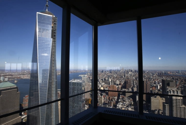 A view of the One World Trade Center tower and the Manhattan skyline is seen from the 68th floor of the soon to be opened 4 World Trade Center tower in New York, November 8, 2013. 4 World Trade center sits at the south east corner of the World Trade Center site and will be the second tower to open on the site since the 2001 attacks on the World Trade Center. REUTERS/Mike Segar (UNITED STATES - Tags: BUSINESS CITYSCAPE)