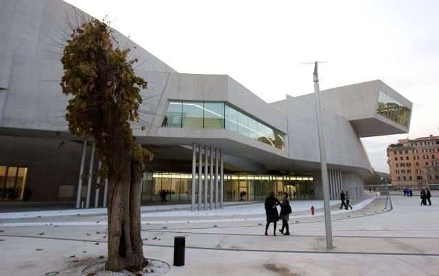 Guests walk outside Maxxi museum of contemporary art and architecture in Rome November 13, 2009. The museum, designed by Iraqi-born architect Zaha Hadid, opens its doors to the public in Spring of 2010. REUTERS/Max Rossi (ITALY ENTERTAINMENT)