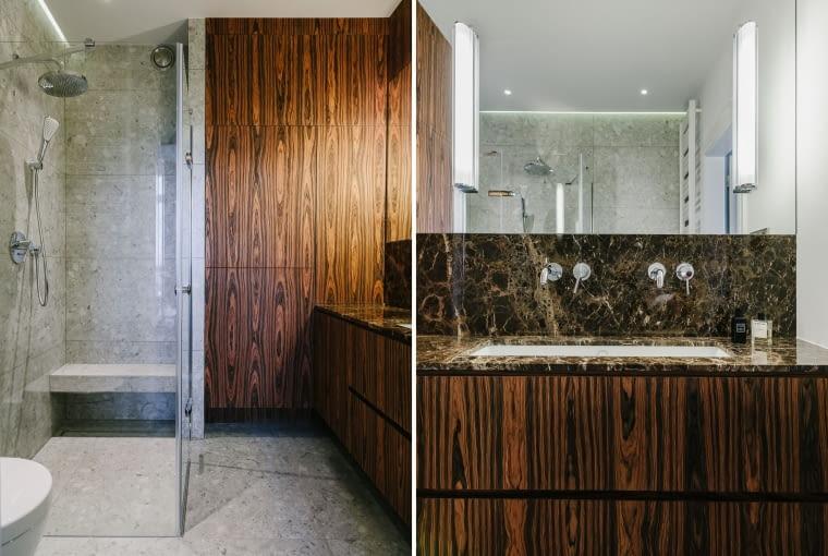 Aranżacja łazienki to połączenie forniru palisander, marmuru Emperador Gold i płytek w odcieniach szarości.