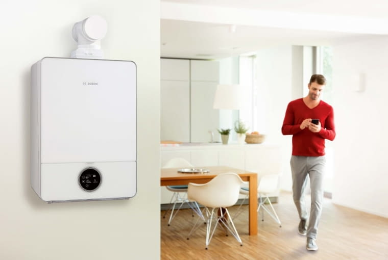 Nowoczesnego, wiszącego kotła na gaz nie trzeba ukrywać w pomieszczeniu technicznym - można go umieścić na przykład w łazience lub kuchni