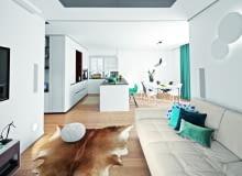 Na otwartą strefę dzienną składa się przedpokój, kuchnia z jadalnią i salon. Takie rozwiązanie sprzyja rodzinnej integracji; większość czasu domownicy spędzają w strefie dziennej. Na sofie Maxdivani poduszki NAP oraz Bo Concept, skóra na podłodze IKEA, puf House & More.