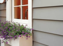 Fiber-cement siding is manufactured to resemble cedar shingles and wood clapboards (either wood-grain or smooth).