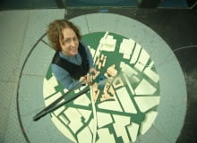ULeeds (Bridgewater Place) - Birds eye shot of Justin towering over small scale model.