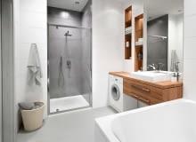 Coraz modniejsze stają się kabiny prysznicowe we wnękach -zastanych lub specjalnie wtym celu wykonanych. Nic dziwnego, bo to wygodne rozwiązanie. Po pierwsze, mamy mniej szklanych powierzchni do umycia, apo drugie, akcesoria można zamontować aż na trzech ścianach.