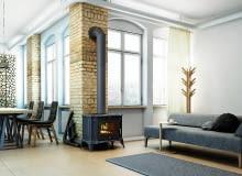 Piec ustawiony w centralnej części salonu, który jest otwarty na pozostałą część domu, w efekcie ciepło rozchodzi się do pomieszczeń znajdujących się w pobliżu kozy