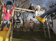 Children Playing in Playground --- Image by Stephen Mallon/Corbis