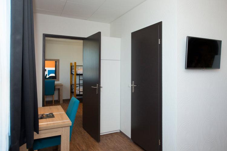 Stapelbedden_in_aparte_kamer_in_Classic_Hotelkamer_Preston_Palace