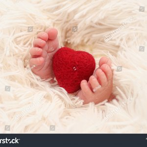 stock-photo-a-red-heart-between-the-legs-of-a-new-born-baby-1966955188.jpg