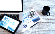 117358643 business analytics with a tablet pc and a laptop