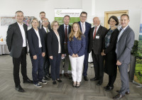 Bundesentwicklungsminister Dr. Gerd Müller zusammen mit dem Vorstand und der Geschäftsführung des Forum Nachhaltiger Kakao (Foto: © Forum Nachhaltiger Kakao)