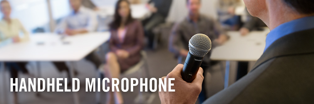 handheld microphone being used at meeting