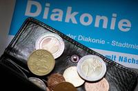 Diakonie geld dpa zentralbild