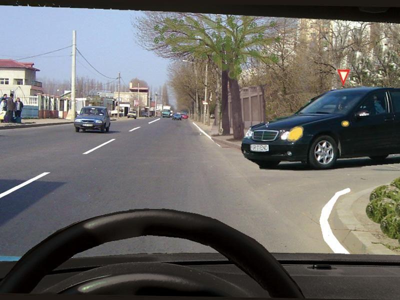 Trebuie să acordaţi prioritate autoturismului negru dacă acesta virează la stânga?