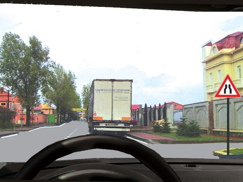 Camionul este staţionat. Cine încalcă legea dacă încercaţi să-l depăşiţi ?