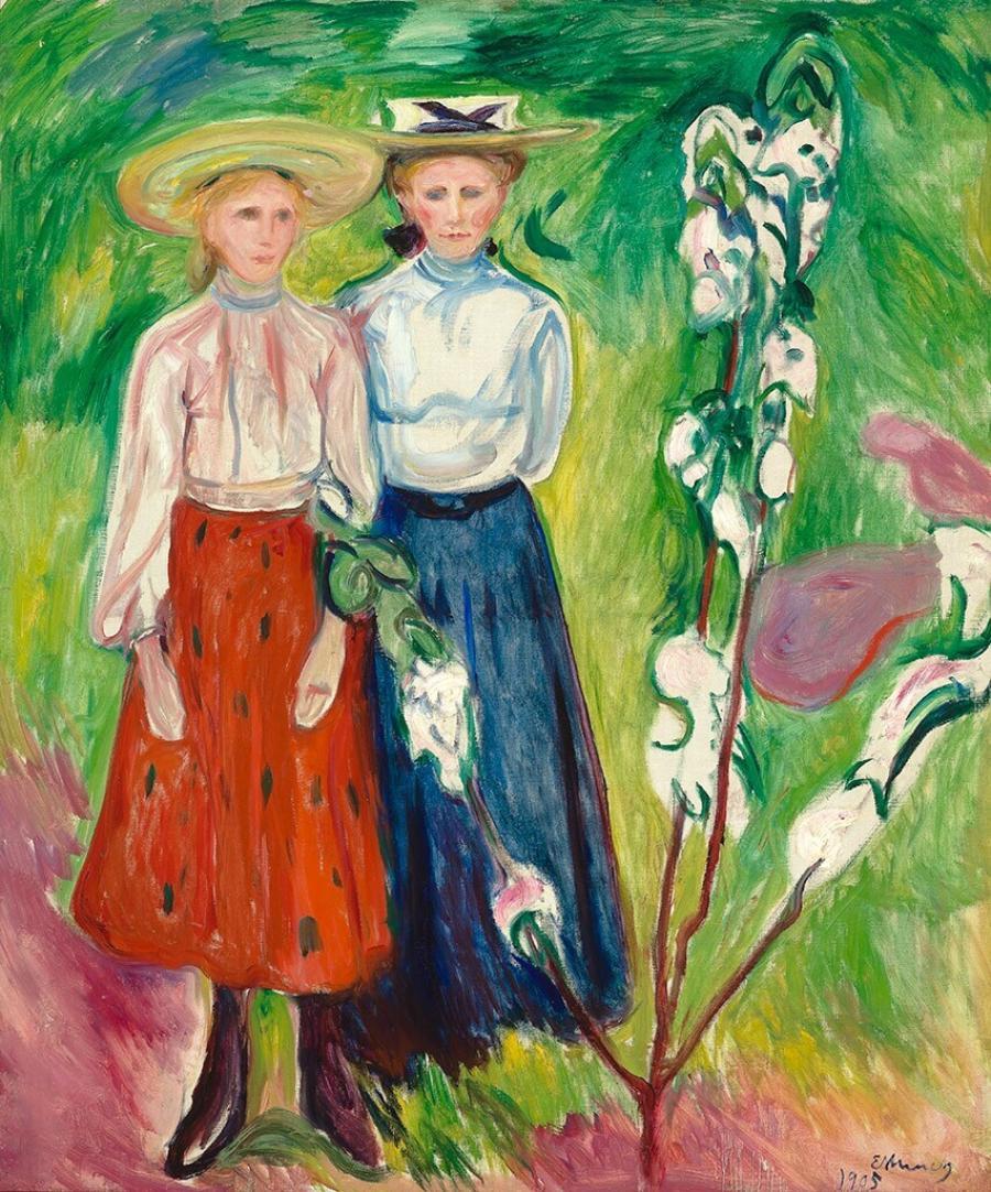 Twee meisjes bij een appelboom
