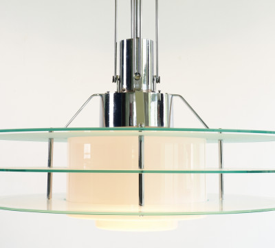 W.H. Gispen, an extra-large pendant lamp for the De Witte Society in The Hague, later marketed as Giso 55a, 1930, chrome-plated cast iron and glass, photo: Ad van den Bruinhorst, Collection: Galerie Van Den Bruinhorst, Kampen.