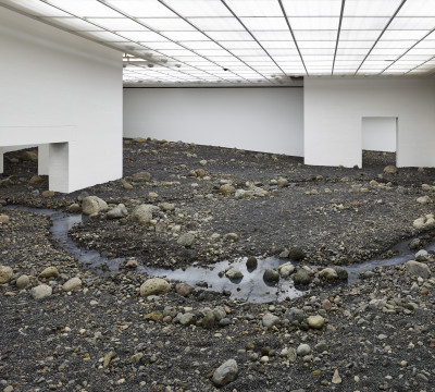 Riverbed, 2014. Water, blue basalt, wood, steel, foil, hose, pumps, cooling unit. Louisiana Museum of Modern Art, Humlebaek, Denmark, 2014 Photo: Anders Sune Berg.