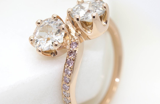 Main old european diamonds in a crown setting engagement ring with pave pink diamond band